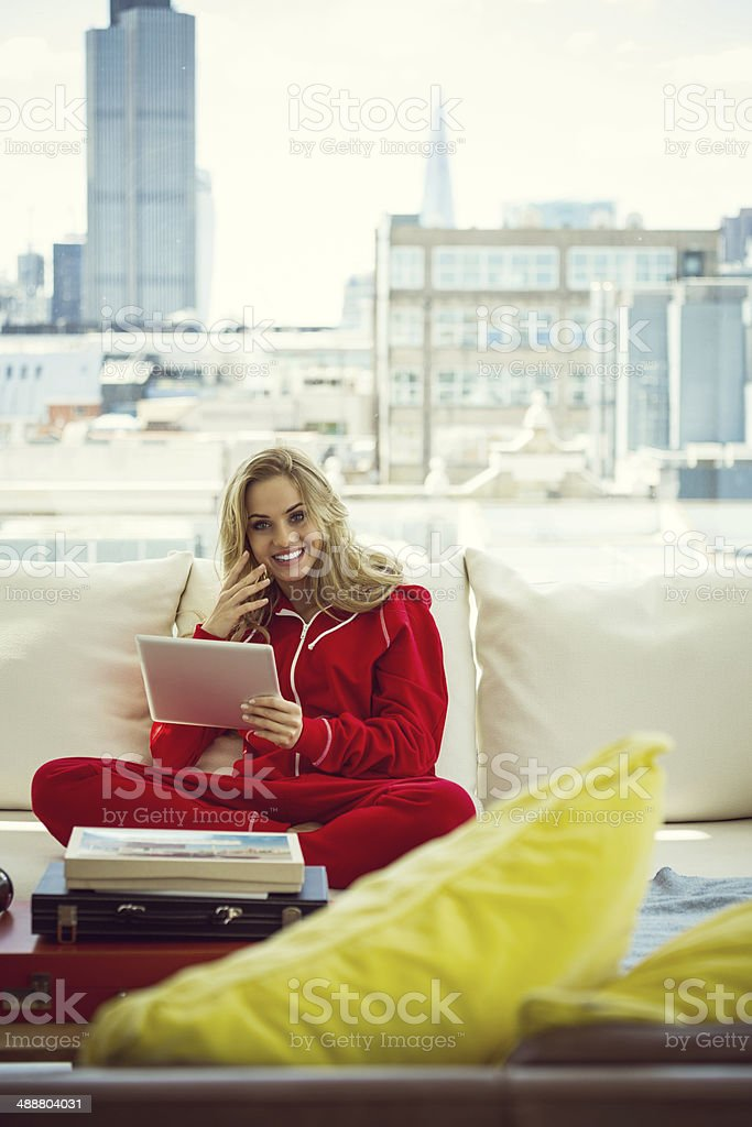 Relax in the morning Young woman sitting on sofa at home and using a digital tablet in the morning. 20-24 Years Stock Photo