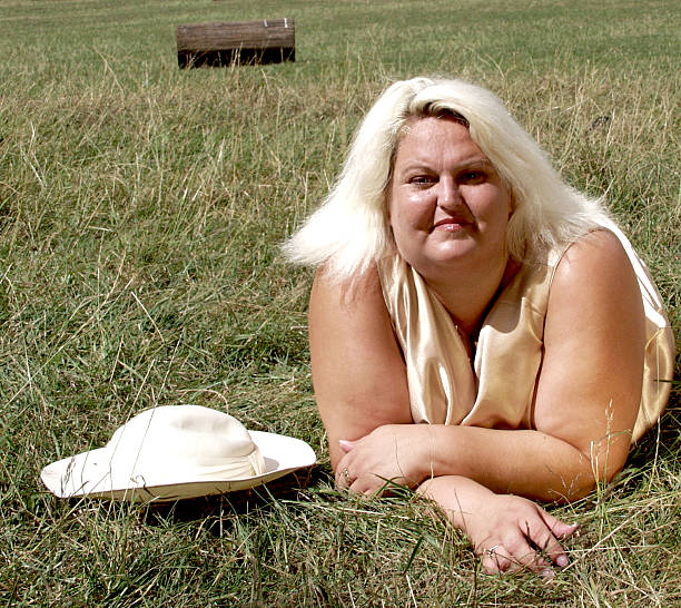 relax in the park - funny fat lady stock photos and pictures