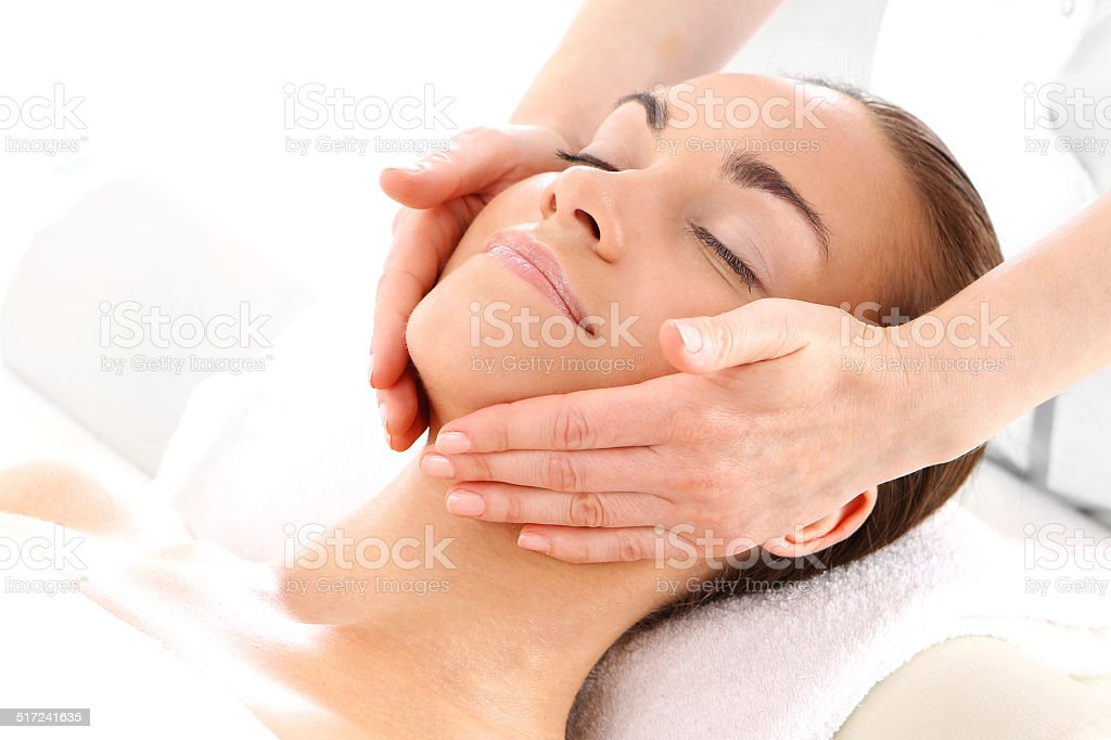 Relax in the spa - woman at face massage stock photo