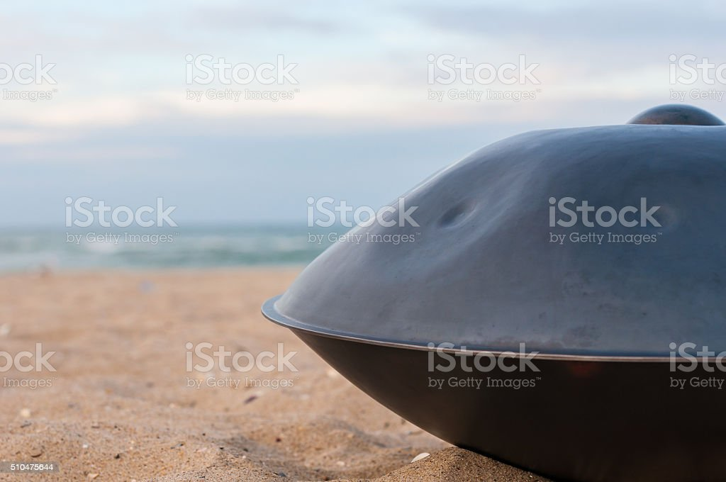 Relax music background. Hands percussion. The Hang or handpan with stock photo