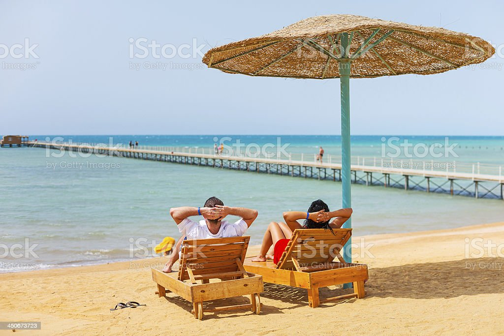 Relax of loving couple on the beach at Red Sea stock photo