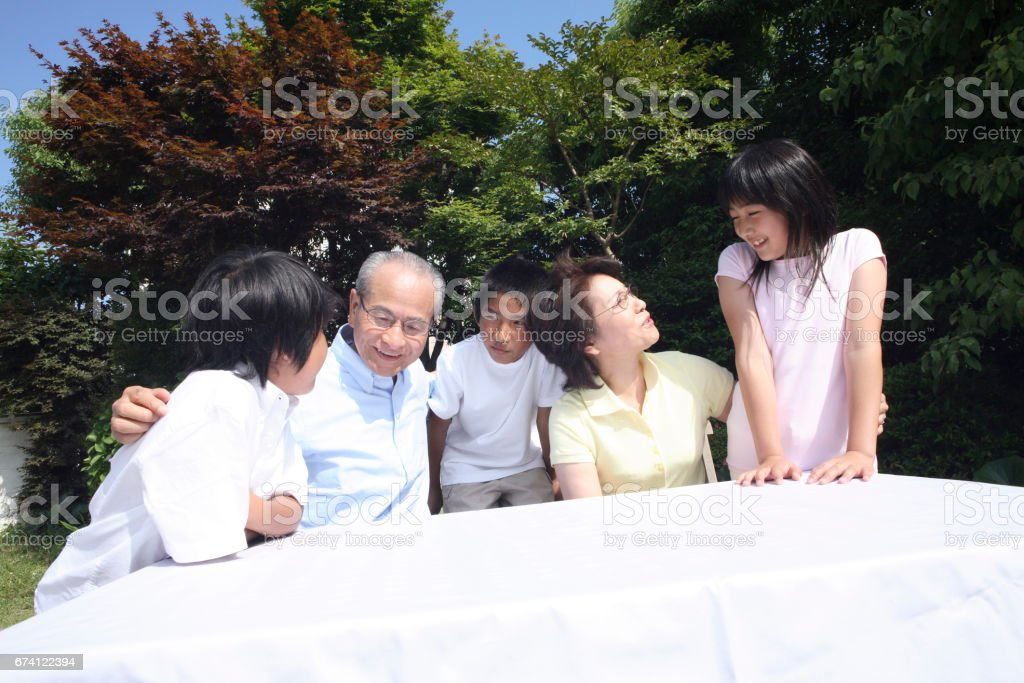 Relax outside the couple and grandchild royalty-free stock photo