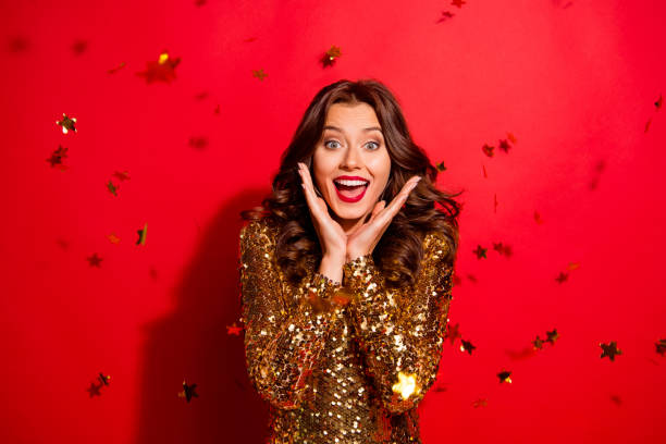 relax, rest concept. stunning, adorable, good-looking lady with modern curly, wave hairdo hold palm near face, open mouth, big eyes isolated on bright red background - smile woman open mouth foto e immagini stock