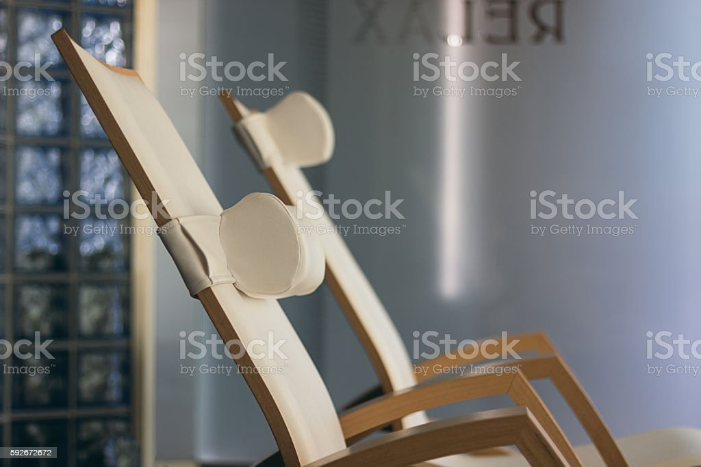 SPA relax room interior, with comfortable wooden loungers. stock photo