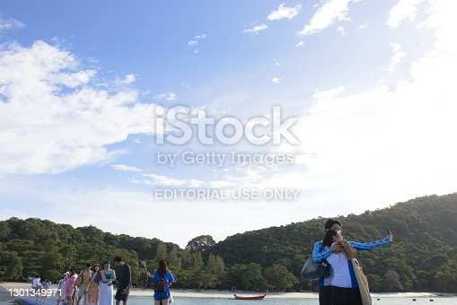 Phuket, Thailand - October 19, 2020 : Relax time, tourists walking on plastic pontoon walk way to the beach after docking by yacht. Koh Racha, Phuket city.