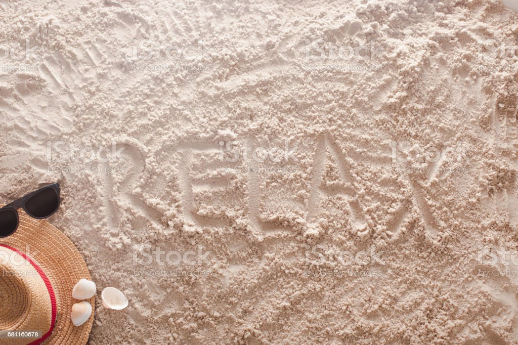 Relax written in a sandy tropical beach royalty-free stock photo