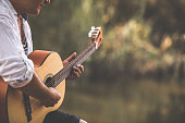 istock Relax yourself playing your favorite tunes on your guitar 1277489716