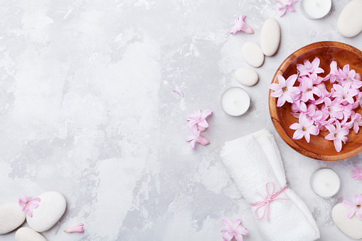 istock Relaxation and zen like concept. Aromatherapy, beauty and spa background with massage pebble, perfumed flowers water and candles. 914800170