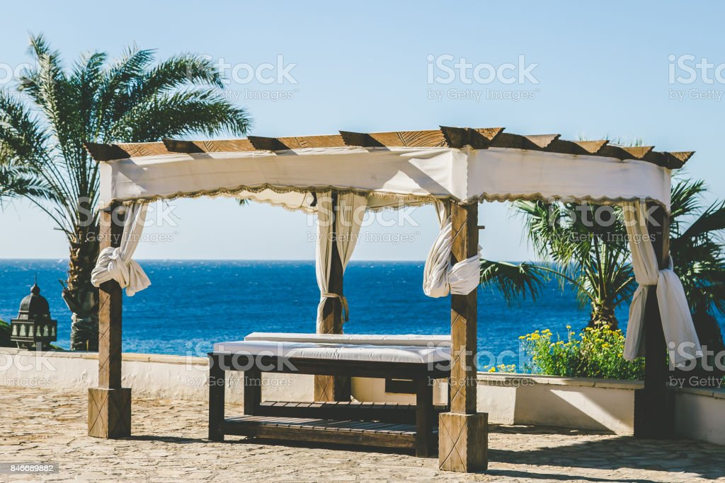 Relaxation area. Massage on the beach stock photo