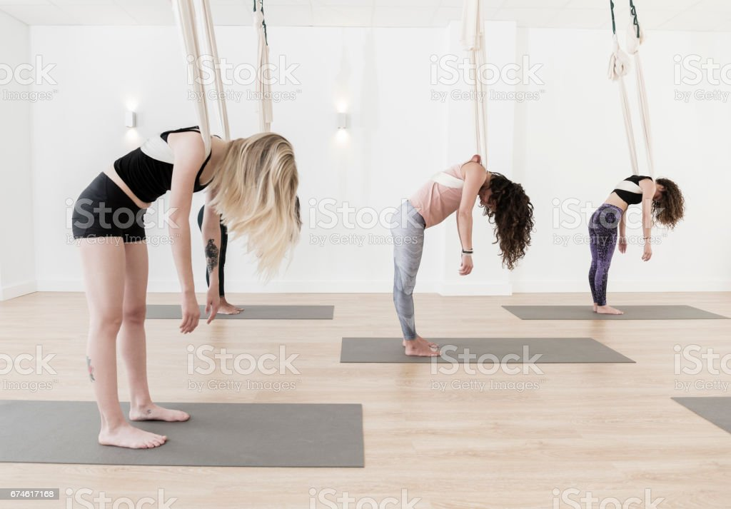 Relaxation durian aerial yoga class stock photo
