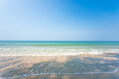 Relaxation seascape. Scenic tropical beach in summer season. Beautiful waves, shadow and light blue sky. Sunshine day. Trat, Thailand. Vacations time. Copy space.