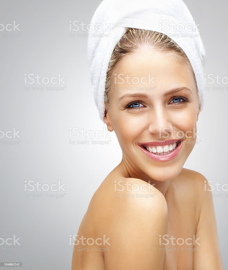Relaxation - Smiling naked woman against grey background royalty-free stock photo