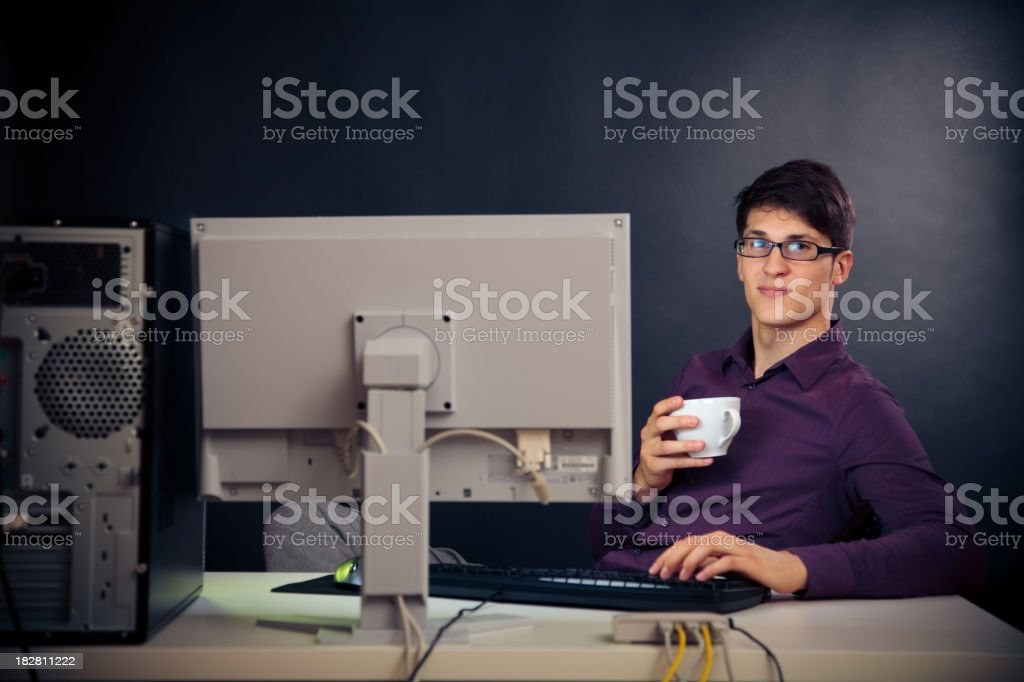 relaxed admin at his desk royalty-free stock photo