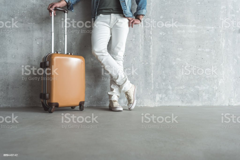 Relaxed adult guy is posing with his bag stock photo