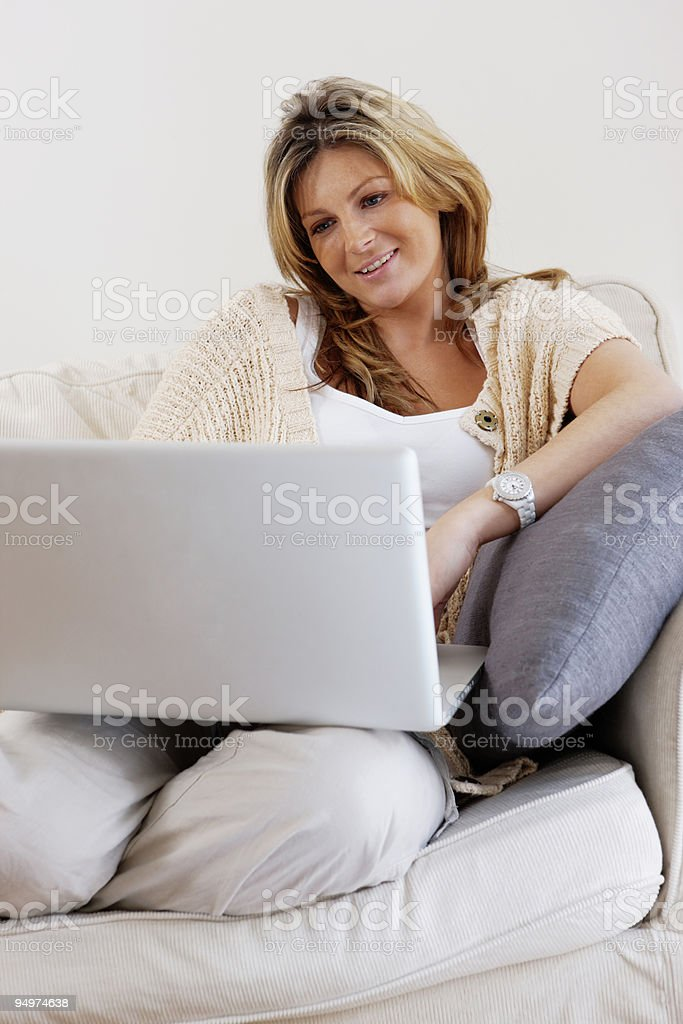 relaxed attractive Woman working on laptop at home royalty-free stock photo