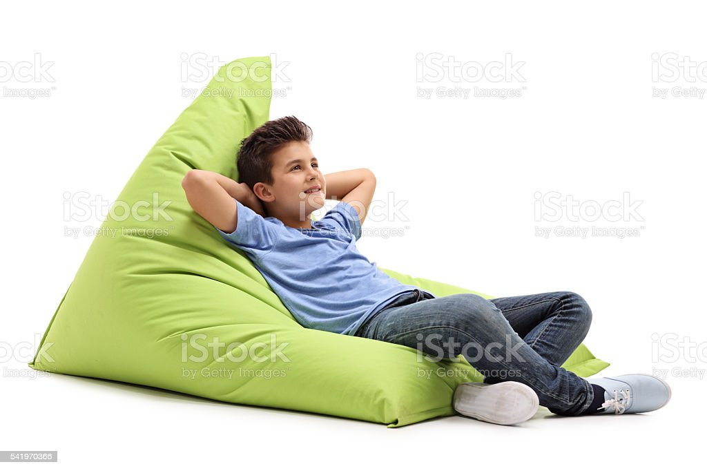 Awesome Relaxed Boy Laying On A Beanbag Stock Photo Download Image Caraccident5 Cool Chair Designs And Ideas Caraccident5Info