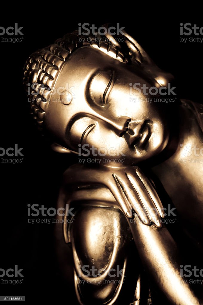 Relaxed buddha statue stock photo