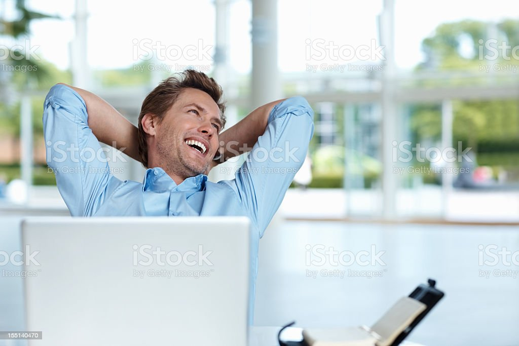 Relaxed business man with a laptop royalty-free stock photo