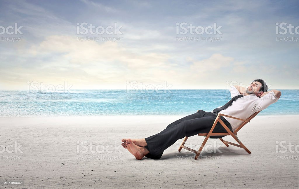 Relaxed businessman stock photo