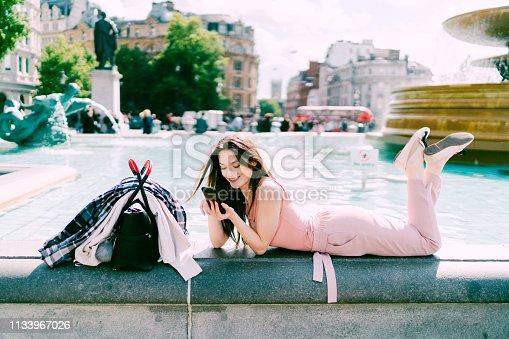 Smiling woman enjoying good news on the phone