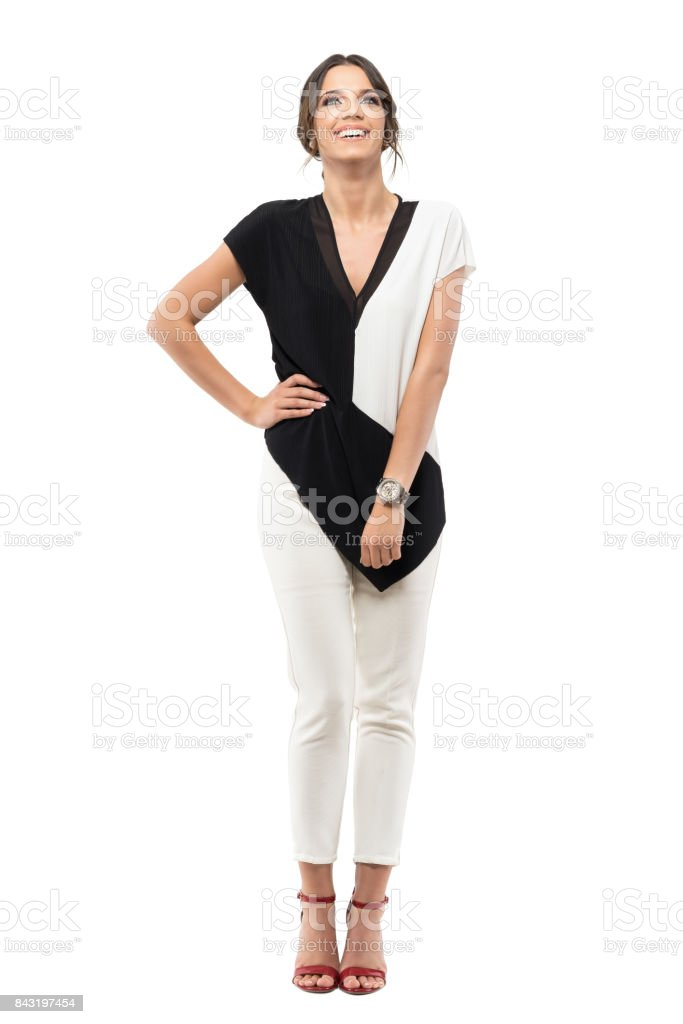 Relaxed carefree young business woman in suit laughing and looking up stock photo