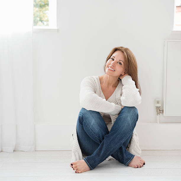 relaxed casual portrait of attractive woman - sitting on floor stock photos and pictures