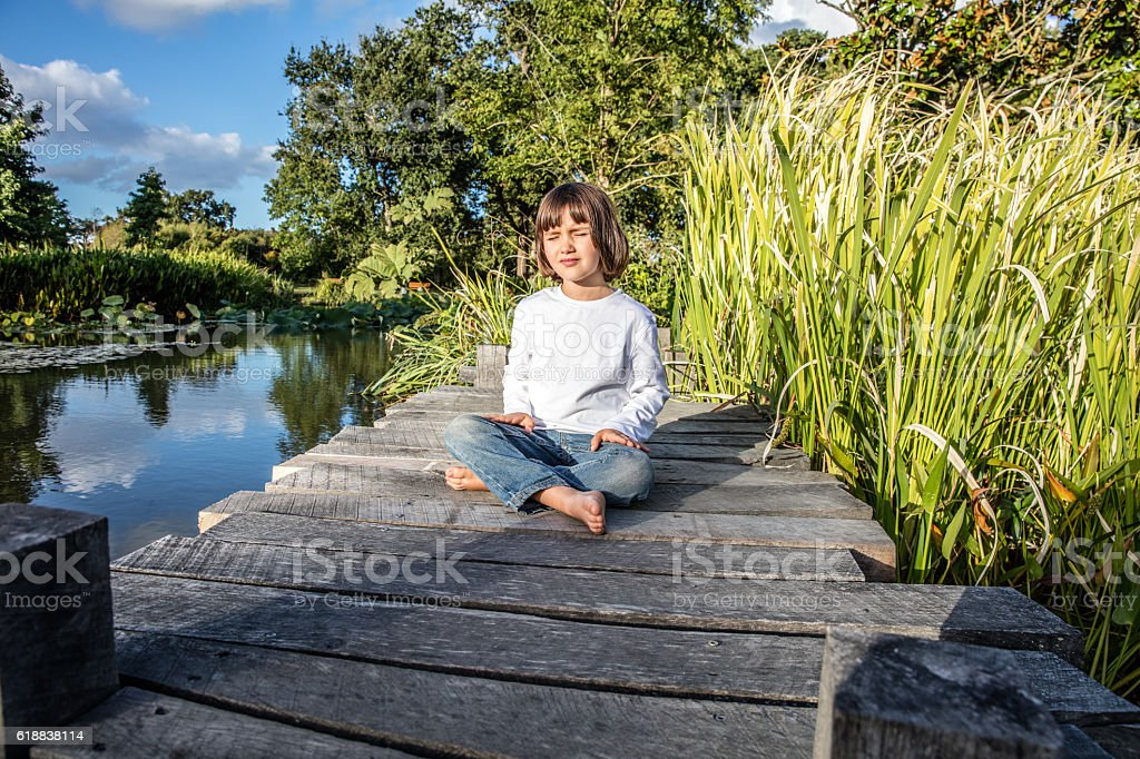 Relaxed Child For Yoga And Meditation Near Water And Trees ...