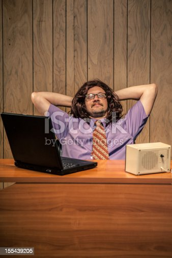 618210072 istock photo Relaxed Computer IT Guy Chilling at his Desk in Office 155439205