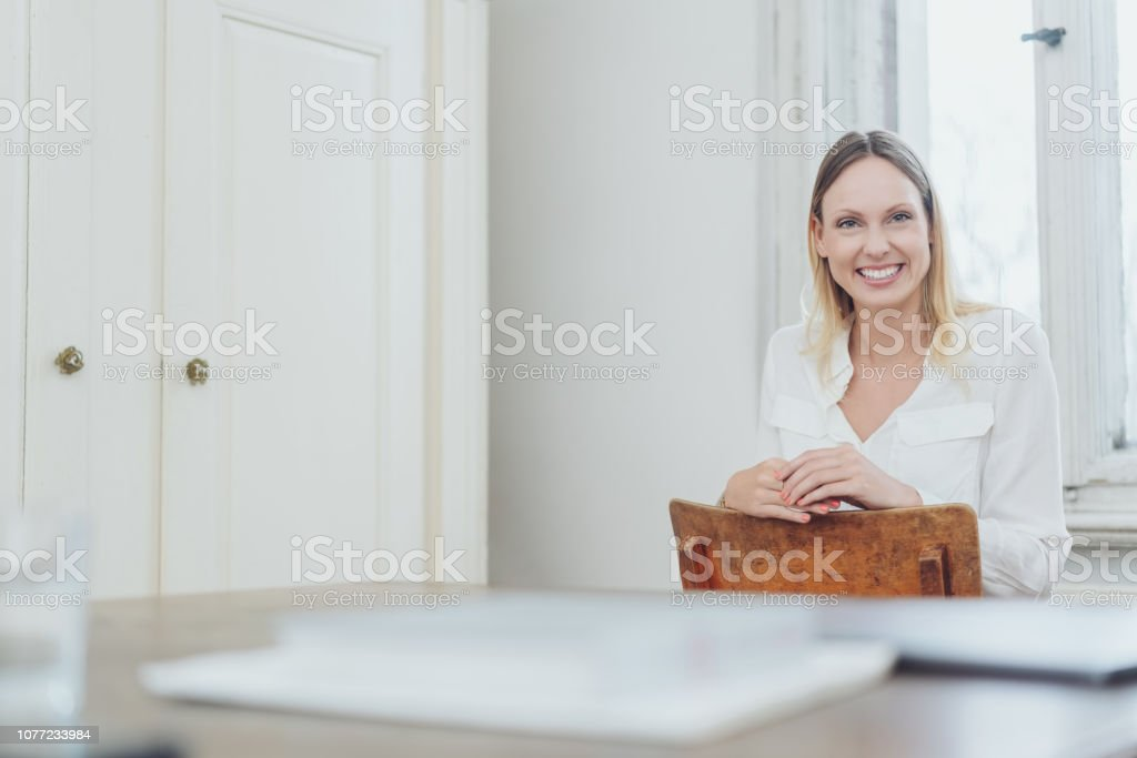 Relaxed confident woman with a friendly smile