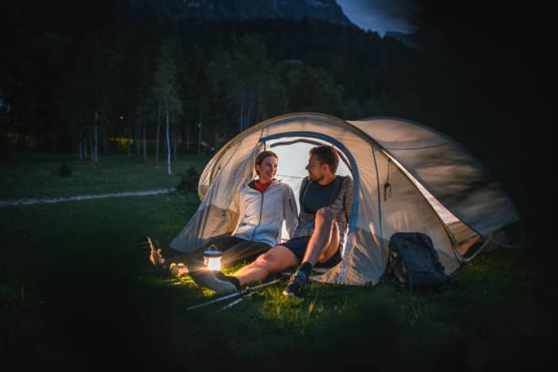 Relaxed Couple Enjoying Camping in Northwestern Slovenia stock photo