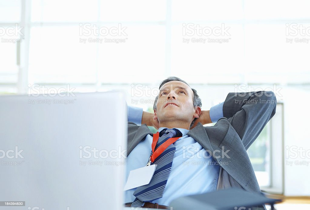 Relaxed executive with laptop royalty-free stock photo