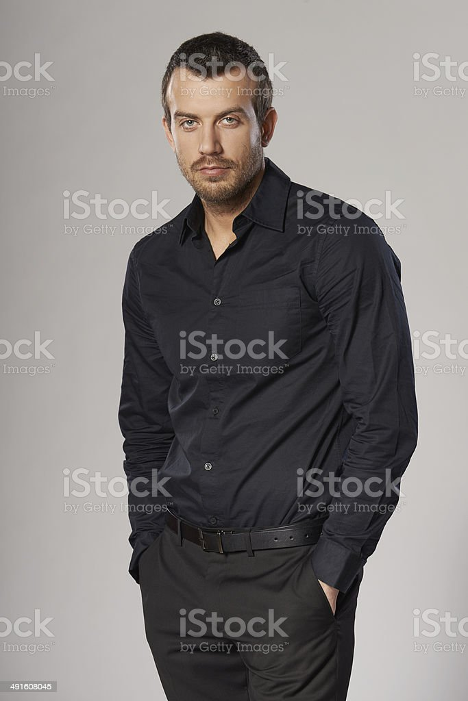 Relaxed fashionable man standing casually stock photo