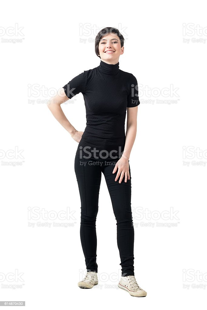 Relaxed fashionable woman in turtleneck t-shirt smiling at camera stock photo