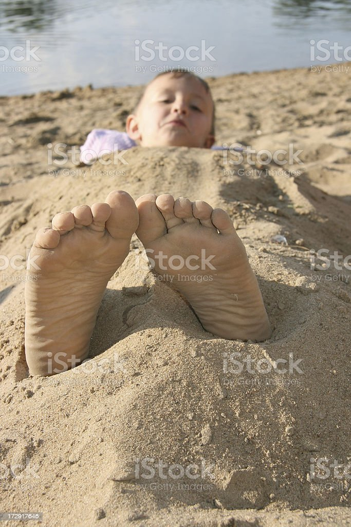 relaxed feet at the beach stock photo