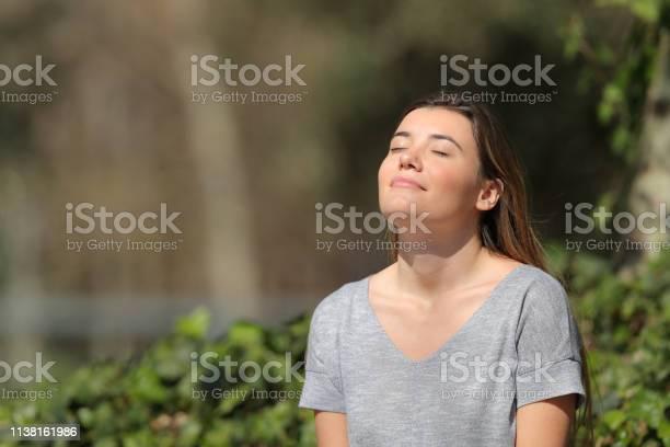 Relaxed girl breathing fresh air in a park a sunny day picture id1138161986?b=1&k=6&m=1138161986&s=612x612&h=br0ajtt1zbrnxlq4plviwhzdzulygu1o14hq8lhkqbi=