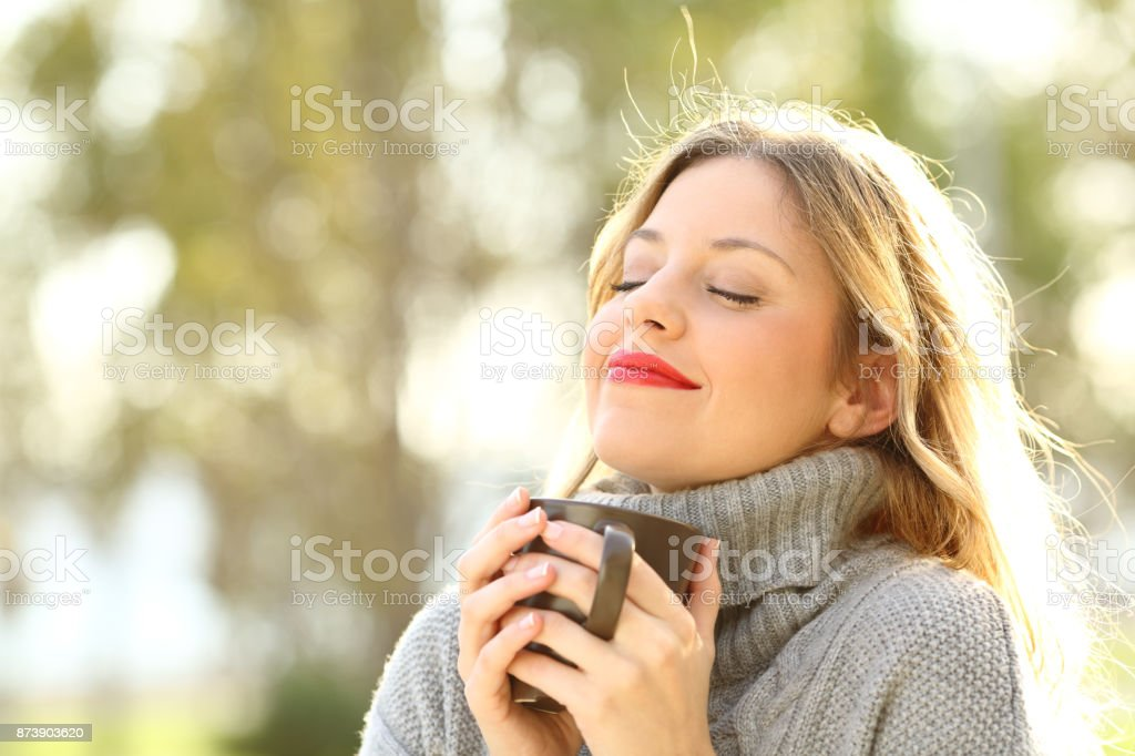 Relaxed girl breathing outdoors in winter stock photo