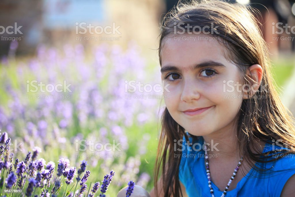 Relaxed girl next to lavender flowers royalty-free stock photo