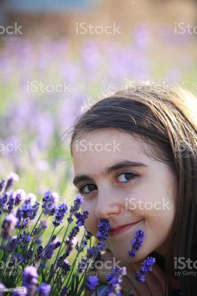 Relaxed girl smelling lavender flowers royalty-free stock photo