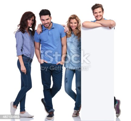 istock relaxed group of people showing a blank board 482103943
