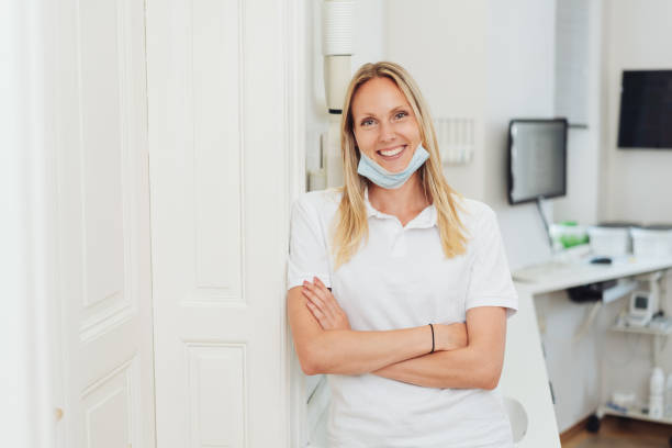 Relaxed happy dental nurse smiling at the camera stock photo