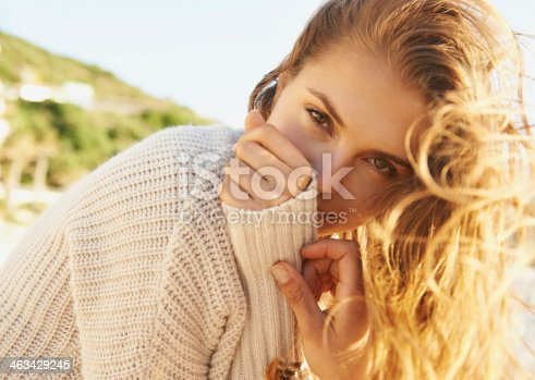 Portrait of a pretty young woman relaxing on the beach in the sunshine