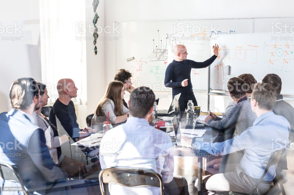 Relaxed informal IT business startup company team meeting. royalty-free stock photo
