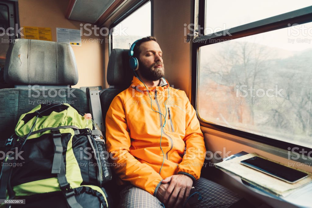 Relaxed man in the train stock photo