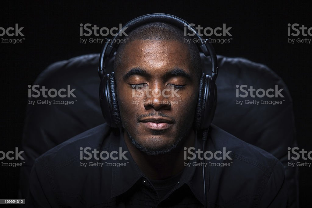Relaxed Man Listening to Music stock photo