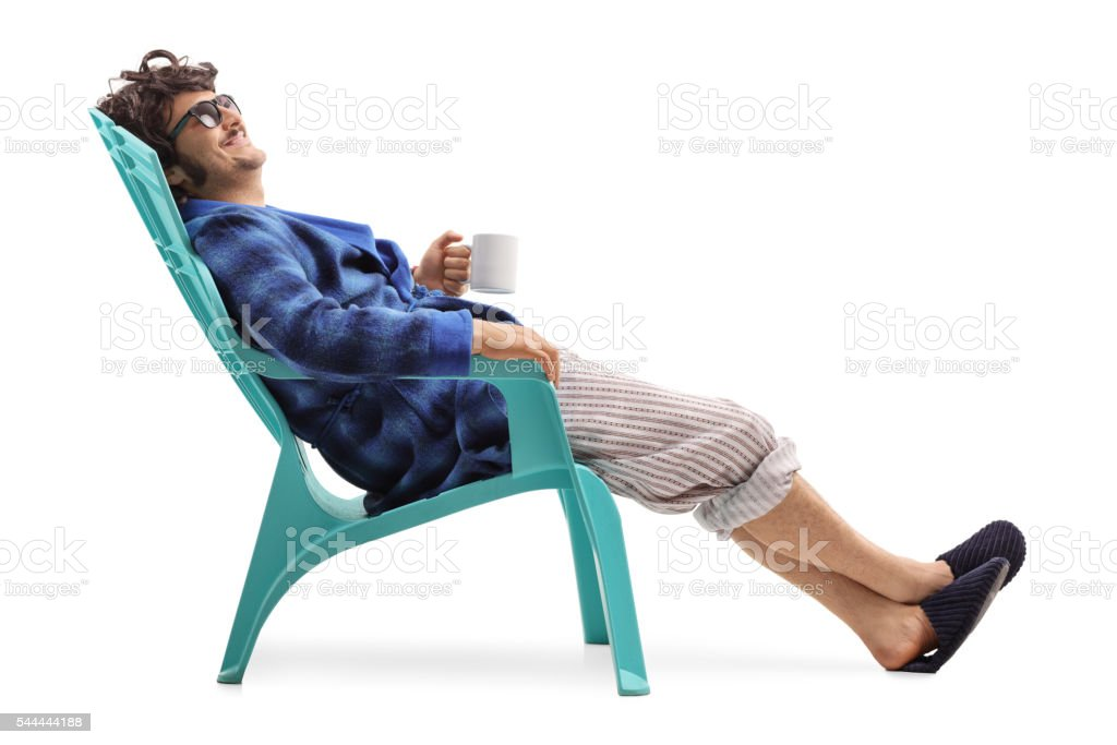 Relaxed man sitting on a plastic chair stock photo