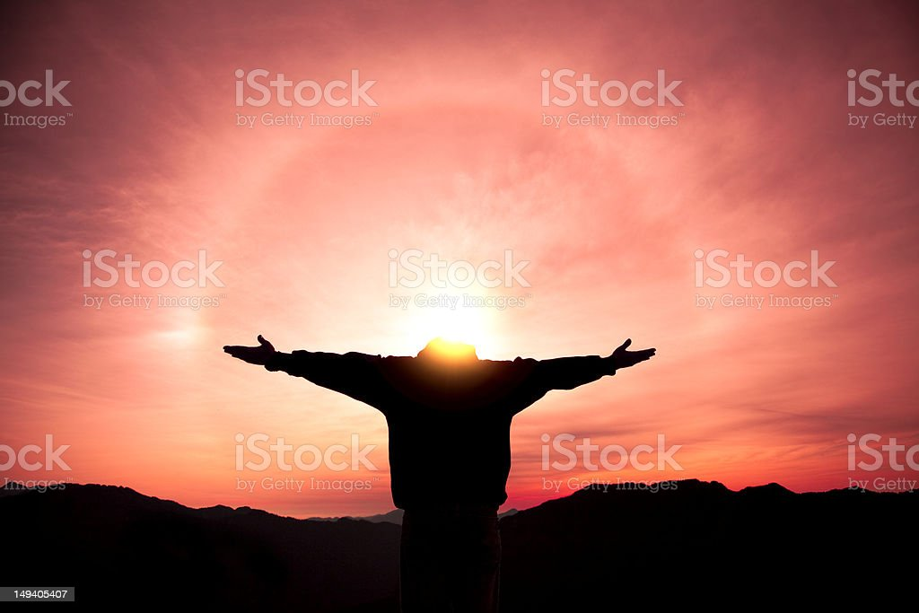 relaxed man standing on the top of mountain stock photo