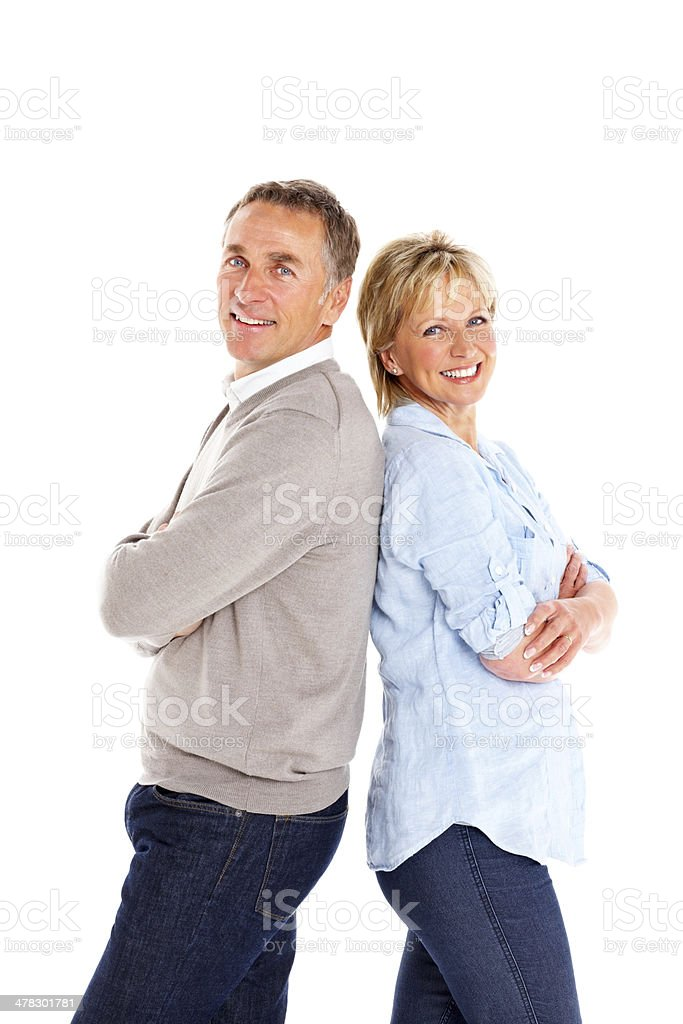 Relaxed mature couple standing on white royalty-free stock photo