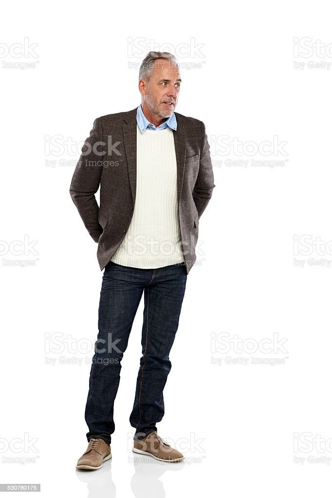 Relaxed mature man looking away at copyspace stock photo