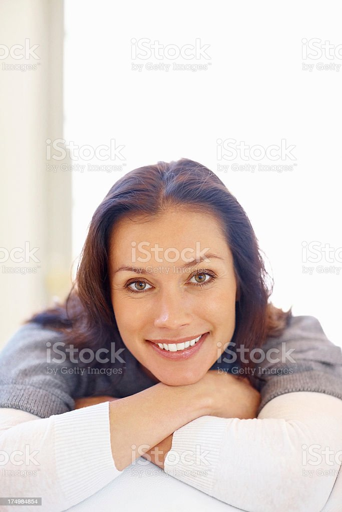 Relaxed middle aged female giving you a cute smile royalty-free stock photo