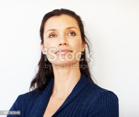 istock Relaxed middle aged woman looking away at copyspace 183260549